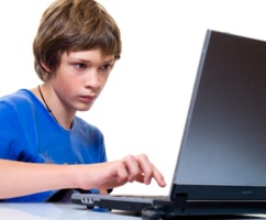 Boy playing on a computer