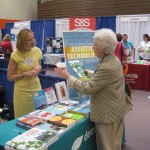Suzanne talks with an attendee at SUNY