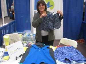 Susan Kleiman displays clothes from her company's line of apparel.