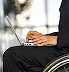 Wheelchair user with laptop