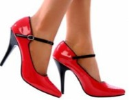 a pair of red high heels on a woman's feet