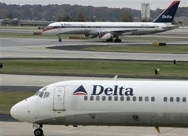 A delta air airplane on runway