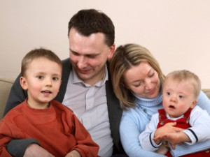 Family of four with a Down syndrome child