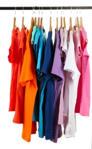 Clothes differently colored on a rack