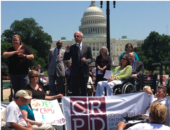Tony Coehlo speaks to a crowd at a Washington rally about CRPD